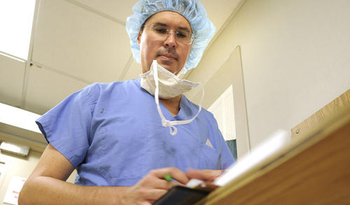 Cancer surgeon Rick Boulay, M.D. checks notes on a patient during rounds between surgeries. Boulay is chief of the division of Gynecologic Oncology at Lehigh Valley Health Network.