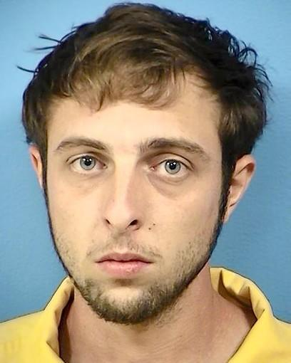 Todd Mandoline, 23, of Villa Park, pleaded not guilty Monday to murder and arson charges.