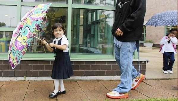 Pre-kindergartners Destiny Ramos, 4, left, and Ayanna Velazquez, 4, walk to their first day of classes Monday at Walsh Elementary School in Chicago's Pilsen neighborhood.