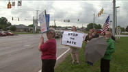 Protesters gather near controversial Elkhart billboard