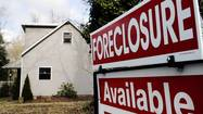 Auctions of foreclosed homes in the Chicago area more than doubled during the first half of the year, taxing the resources of court systems and potentially delaying a housing recovery as those homes slowly make their way to the market.