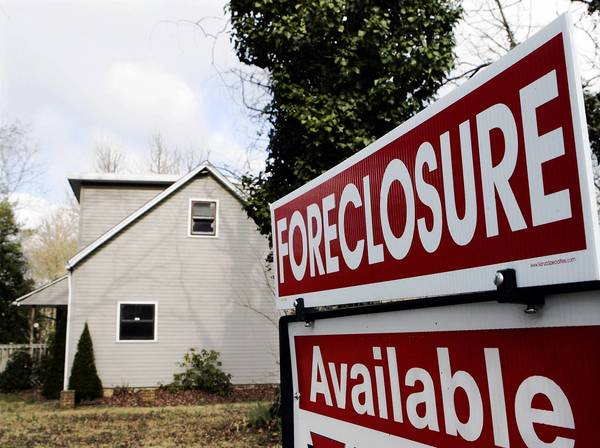 During the first six months of the year, 17,432 homes in the six-county area were auctioned, and 91.3 percent of them were repossessed by lenders and became bank-owned, according to data to be released Tuesday by the Woodstock Institute.