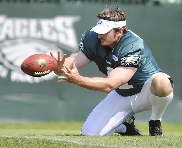 Mat McBriar takes the snap during a field goal drill. The former Dallas Cowboy is vying to win the Eagles' punting job.