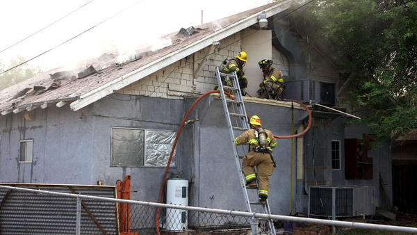 El Centro firefighters extinguish fire on a house on Euclid Avenue and Sixth Street in El Centro on Monday. Interim Fire Chief Tim Reel said three fire engines and 16 firefighters responded to the 3:40 p.m. call.