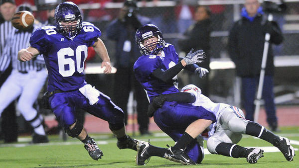 Parkland's Dan Castillo (31) right, forces East Stroudsbug South's Zack Nearhoof (9) center, to fumble the ball on a kick-off in the first quarter during the PIAA District 11 4A semifinal football game held at East Stroudsburg South stadium Friday night November 20, 2009.