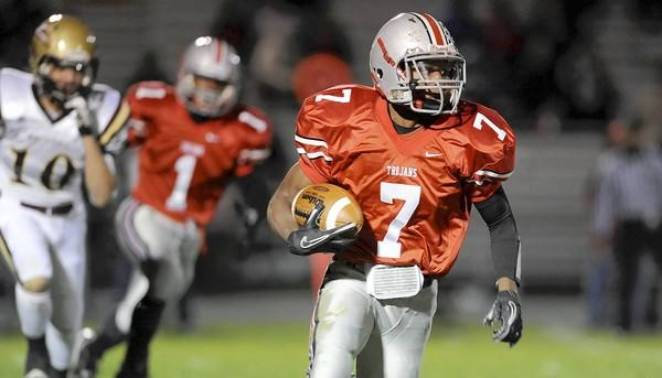 Parkland's Jarel Elder carries the ball against Whitehall in a game last November.