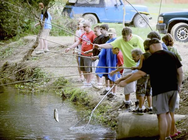 Children fish during the Lehigh Valley Hunting and Fishing Extravaganza at the Kempton Fairgrounds last August.