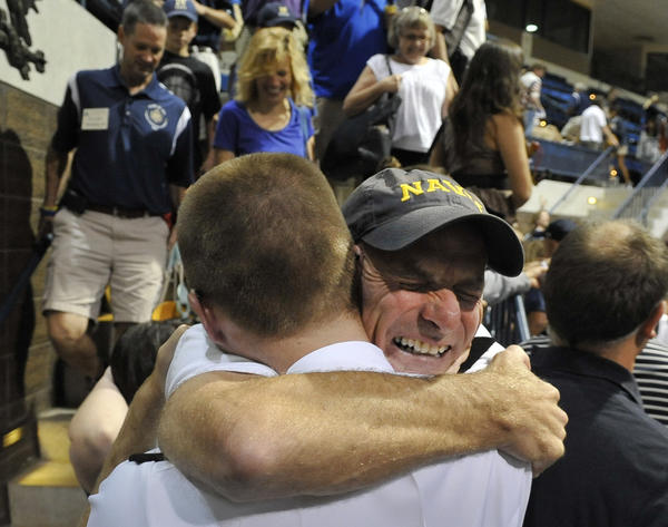 Frank Gilliam of Huntington, W.Va., hugs his son, Ian Gilliam after the Plebes were given their leave. Friday, Aug. 10 marks the start of Plebe Parents Weekend at the United States Naval Academy.  It is the first opportunity plebes have to spend time with their families since they began Plebe Summer six weeks ago on Induction Day. The Class of 2016 will reunite with their families after noon meal formation.