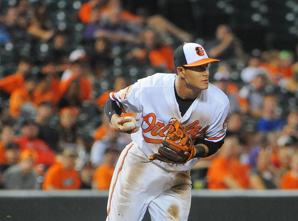Orioles 3rd baseman Manny Machado makes a pick-up on the one hopper in the 6th inning by Lorenzo Cain, and on a fielders choice tosses to 2nd for the force of Alcides Escobar to end the inning. The Kansas City Royals are in town to take on the Baltimore Orioles.