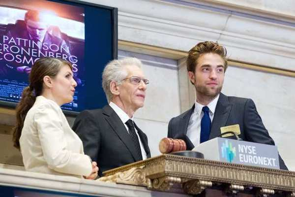 "Robert Pattinson and David Cronenberg ring the opening bell at NYSE to promote their upcoming film, ""Cosmopolis."""