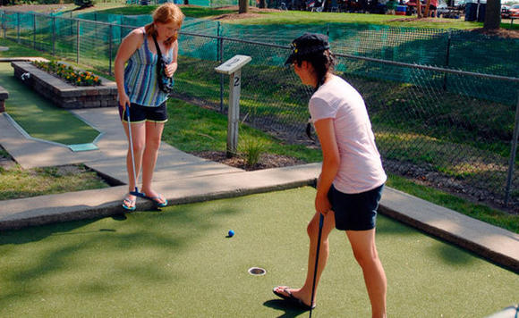 Tinley Junction Mini Golf & Batting Cages in Tinley Park offers an 18-hole course with a garden model railroad.