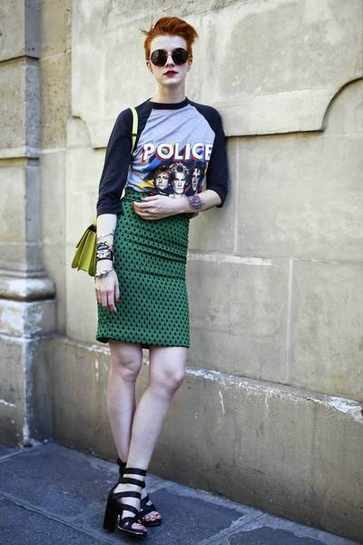 Womanl with red hair and police t-shirt in Paris