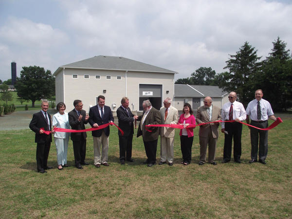 Participating in the July 16 ribbon-cutting ceremony at Fahrney-Keedy Home & Village's expanded wastewater treatment plant are, from left, Jack Tarburton, state director of the U.S. Department of Agriculture Rural Development program; Julianna Albowicz, representative of U.S. Sen. Barbara Mikulski, D-Md.; Robin Summerfield, representative of U.S. Sen. Benjamin Cardin, D-Md.; Alex Mooney, representative of U.S. Rep. Roscoe Bartlett, R-Md.; Keith Bryan, president and chief executive officer of Fahrney-Keedy; Joseph Dahms, chairman of the Fahrney-Keedy board of directors; Lerry Fogle, vice chairman of the board of directors; and board members Karen Kiley, Ed Brewer, Charles Wiles and the Rev. Loyal Vanderveer.