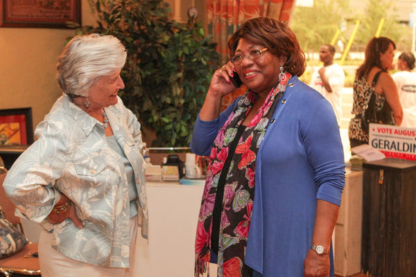 Former Orange County Mayor Linda Chapin listens as State Senate candidate Geraldine Thompson is congratulated on the phone by former Rollins College president Rita Bornstein at the Wells' Built Museum of African American History in Orlando, Fla. on Tuesday, August 14, 2012.