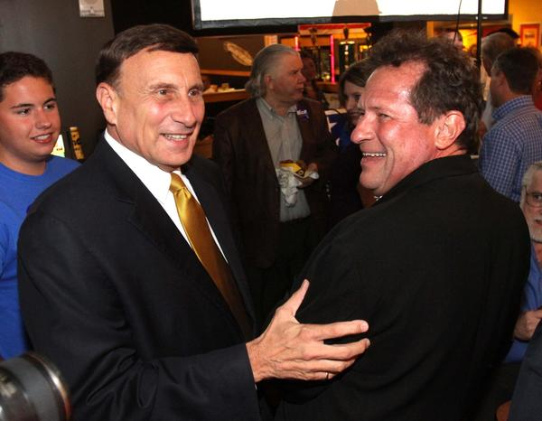 Incumbent congressman Rep. John Mica celebrates his win over challenger Sandy Adams, with close friend Fred Leonhardt (right) during his primary election night party at Buffalo Wild Wings restaurant, in Casselberry, Tuesday night, August 14, 2012.