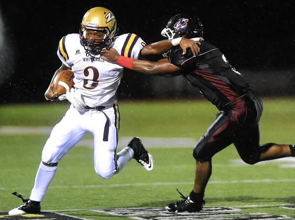 Running back James Wah (3), now a senior, averaged 8.2 yards on 45 attempts last season for Whitehall.
