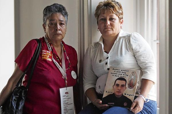 Maria Herrera, left, and Araceli Magdalena Rodriguez are in Los Angeles on the Caravan of Peace. Herrera's four sons have all disappeared. Rodriguez's son, a federal police officer, was executed by organized crime figures.