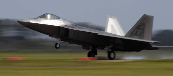 An F-22 Raptor touches down after returning to Langley Air Force Base from a training mission.