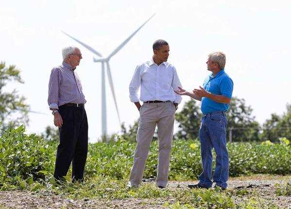 President Obama visits the Heil family farm in Iowa, which grows corn and soybeans while also generating wind energy with several turbines.