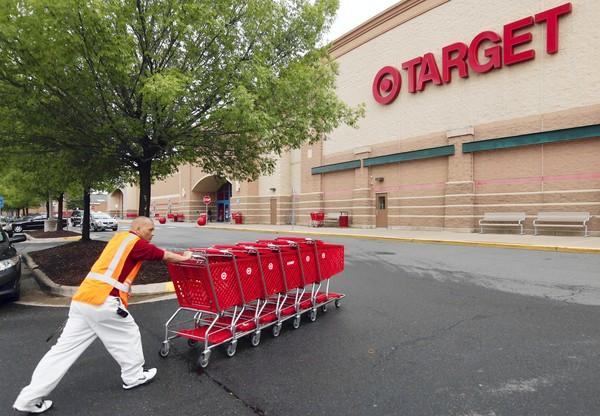 A Target employee returns carts to the store in Falls Church, Virginia. Retail sales rose 0.8 percent in July, well above analysts' expectations.