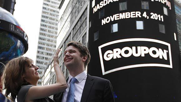 Groupon Chief Executive Andrew Mason poses with his wife, pop musician Jenny Gillespie, outside the Nasdaq Market following his company's IPO in New York November 4.