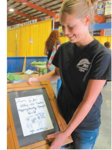4-Her Alexandra Stange, 12, holds the drawing she plans to show judges for the visual arts category at the Brown County Fair on Monday American News Photo by Alison