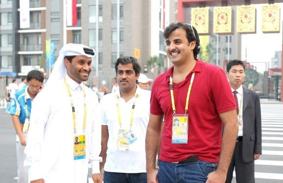 Qatar Olympic Committee president Sheikh Tamim Bin Hamad Al-Thani (left) at the 2008 Olympics