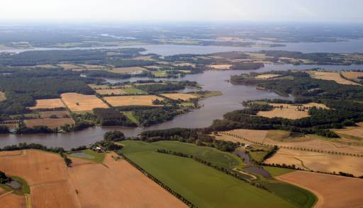 """Farms like these along the Chester River may be able to sell nutrient pollution """"credits"""" by reducing their runoff. A new report warns against allowing such deals to permit worse water quality in urban areas."""