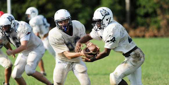 Northern Lehigh's Danny Marsh hands off to Antoine Davis in a drill in practice early Wednesday.
