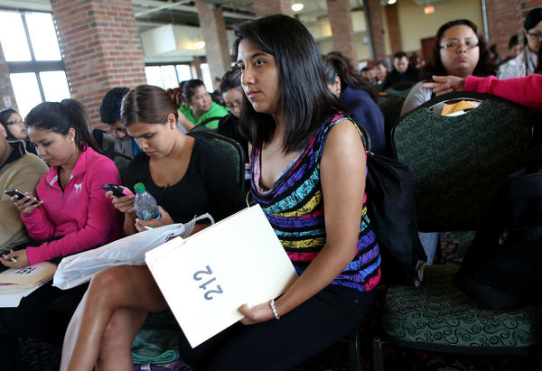 Janeth Vazquez, of Melrose Park, waits with paperwork in hand for the Dream Relief workshop at Navy Pier.