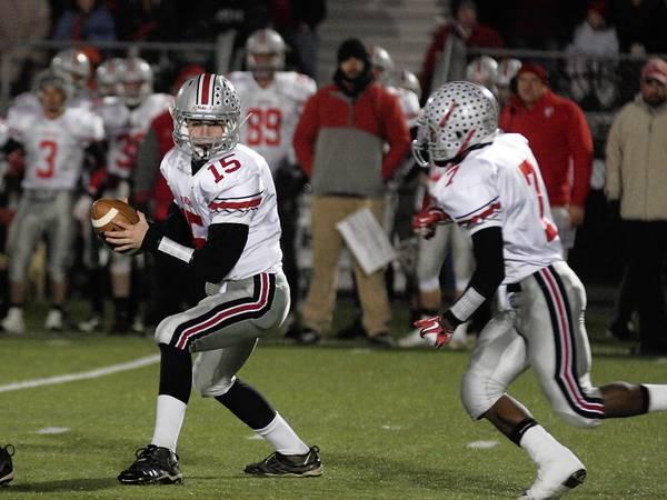 Parkland quarterback Tim Baranek hands off to running back Jarel Elder against Nazareth.