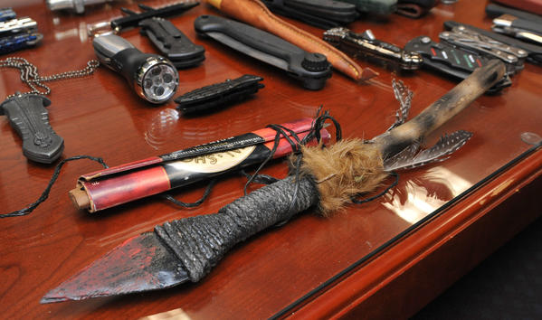An array of weapons confiscated by the TSA at the airport.