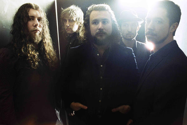 Jim James (center) and My Morning Jacket perform at Merriweather Post Pavilion this weekend.