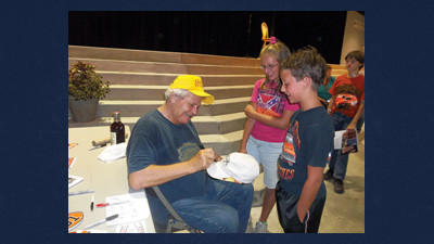 """Madi Conn, 12, of Confluence and her cousin, Hunter Holliday, 9, waited in line for over an hour Aug. 2 at Garrett County (Md.) Fair to see Cooter (Ben Jones), the actor who played the mechanic on """"The Dukes of Hazzard,"""" a television show that aired on CBS from 1979 to 1985. Madi is one of many younger fans who turn to older televisions shows instead of watching popular ones today."""