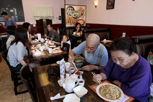 Diners enjoy the food food at Hui Tou Xiang Noodles House.