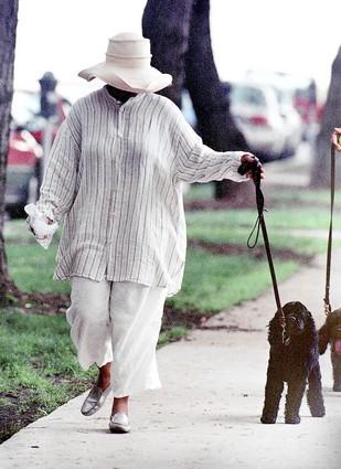 Oprah Winfrey, not only a successful talk show host, but also an accomplished actress, walks her dog at a park near her home in downtown Chicago.