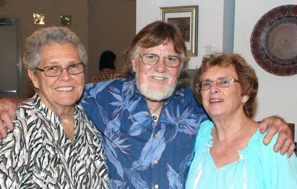 Artist Joyce Kaminski, left, with Claude and Ann Hulce enjoying the evening at the Burbank Creative Arts Center.