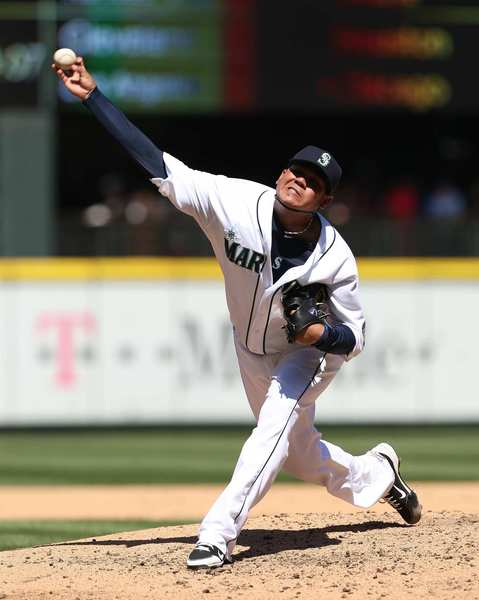 Felix Hernandez of the Seattle Mariners delivers during his perfect game against the Tampa Bay Rays at Safeco Field. The Mariners' ace and former AL Cy Young Award-winner has long talked of his desire to achieve pitching perfection. He accomplished it against the Rays, striking out the side twice and finishing with 12 strikeouts.