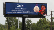 The City of Hampton put up billboards Wednesday along Interstates 64 and 664 to celebrate the achievements of two Hampton Olympians.