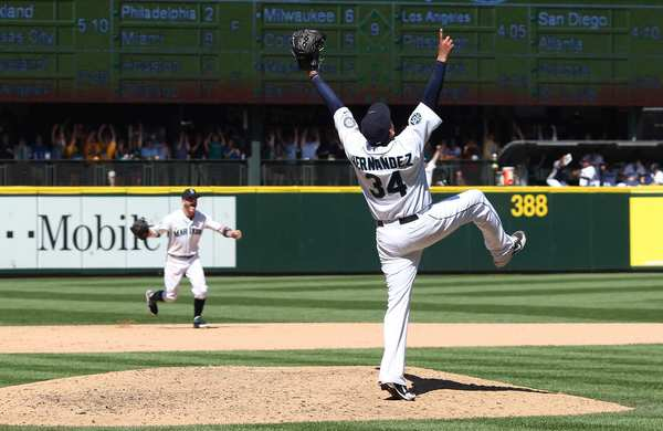 The Seattle Mariners' Felix Hernandez  celebrates after pitching a perfect game against the Tampa Bay Rays at Safeco Field Wednesday in Seattle.