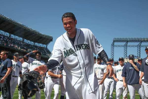 Felix Hernandez is soaked after teammates drenched him with water in celebration of his perfect game against Tampa Bay.