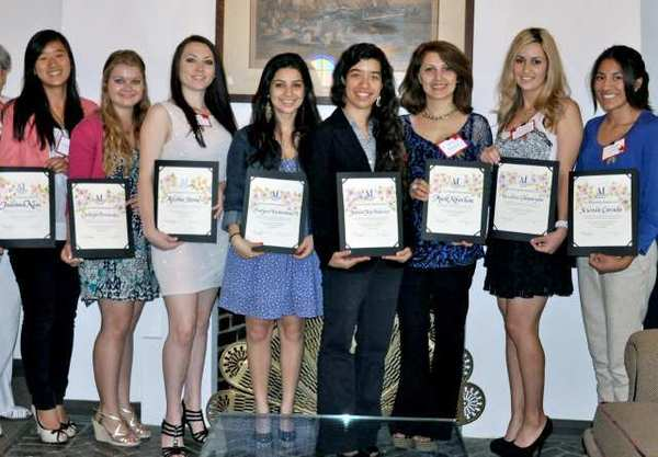Assistance League of Glendale presented scholarships to, from left, Juliana Kim, Carleigh Fernandez, Alisha Stone, Evelyna Vartanians, Jessica Joy Palacios, Anik Khochou, Verzhine Chaparyan and Selenia Corado. ()