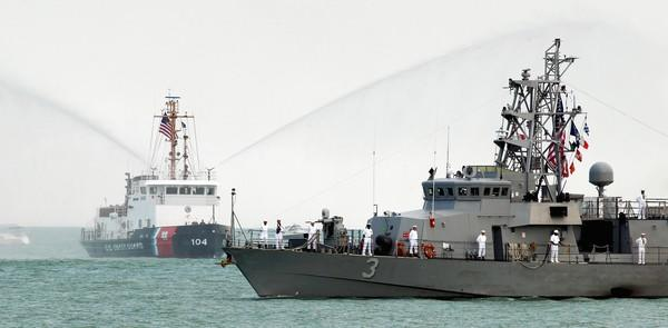 U.S. Coast Guard Cutter Biscayne Bay (left) and U.S. Navy Cyclone Class USS Hurricane approach Chicago's Navy Pier.