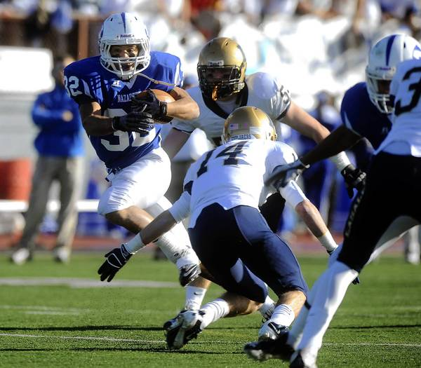 Nazareth's Jordan Gray (32), left, looks for room to run past La Salle College's Jimmy Herron (14) right, in the second quarter during the PIAA Class 4A Quarterfinal football game held at Bethlehem Area School District Stadium in Bethlehem on December 3, 2011.