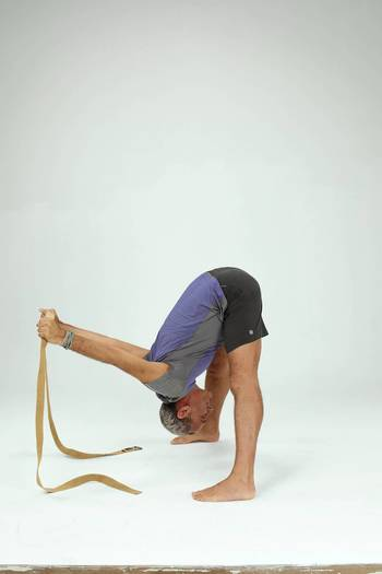 On an exhalation, lead with your chest and fold forward from your hips, lengthening your spine.
