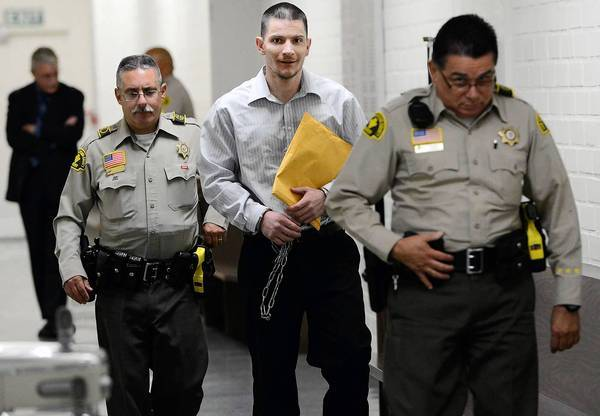 Rickie Lee Fowler is led from a courtroom in San Bernardino County by sheriff's deputies after a jury found him guilty of murder and arson for his role in starting the 2003 Old fire, which led to the deaths of five people and destroyed 1,000 homes.