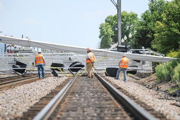 A construction crane that collapsed Wednesday afternoon lies on the three tracks of Metra's Burlington Northern Santa Fe line in Westmont. Trains on the line were delayed for several hours.
