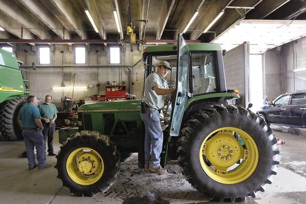 Farm-equipment manufacturer Deere & Co. said Wednesday it lowered its full-year forecast after missing third-quarter analysts' expectations due to weaker international demand and production delays.