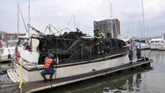 A 40-foot cabin cruiser caught fire in the Anchorage Marina in Canton Wednesday afternoon, bringing multiple fire units to the pier where it was docked, city fire officials said.
