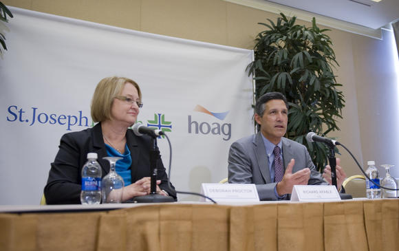 Deborah Proctor, president and CEO of St. Joseph Health, left, and Dr. Richard Afable, president and CEO of Hoag Hospital announce their new partnership.